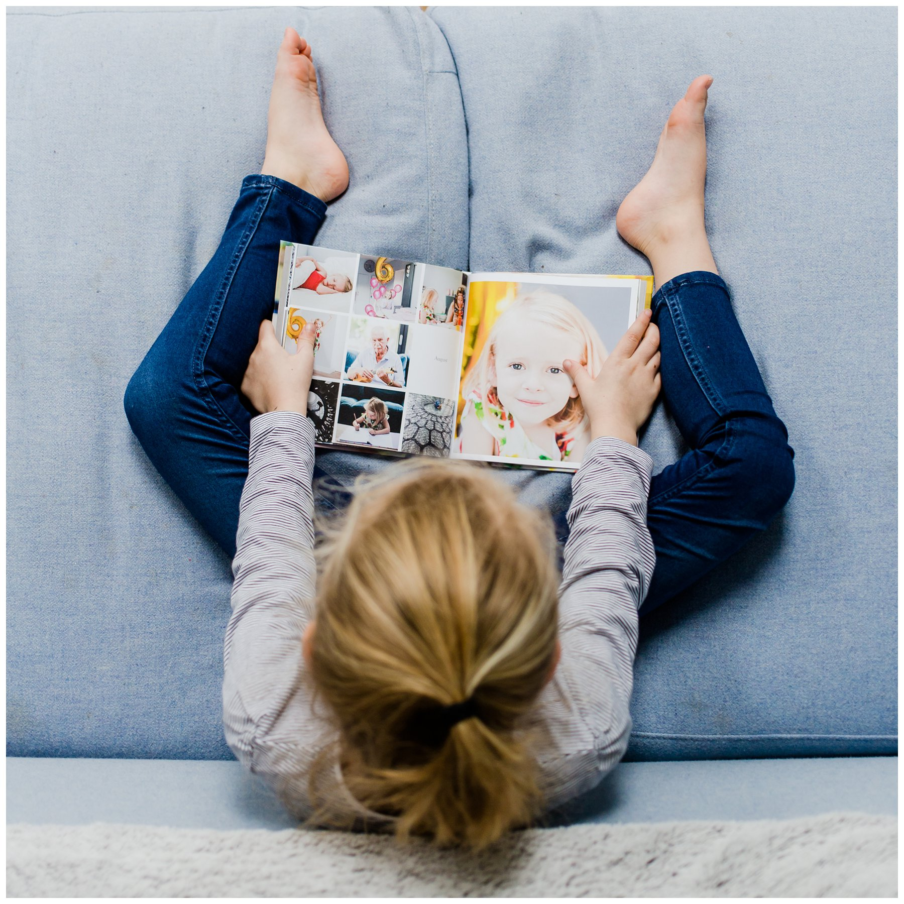 Girl reading photography album