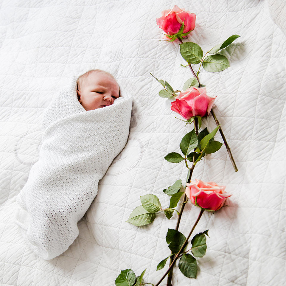 Newborn baby with roses