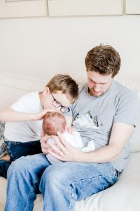 Dad and brother with newborn baby