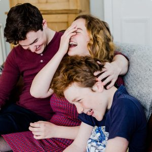 Siblings giggling