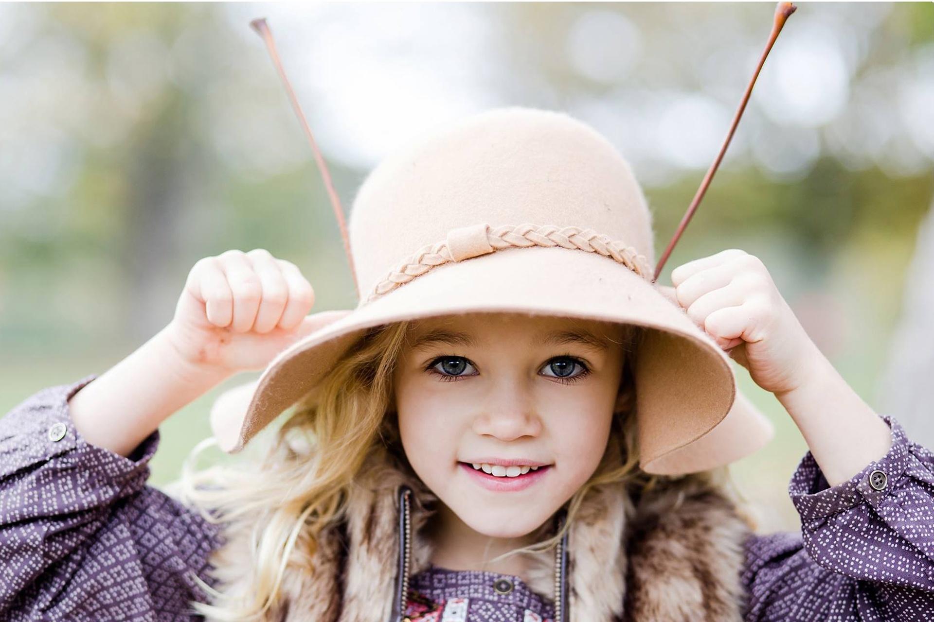 Girl playing with sticks photos