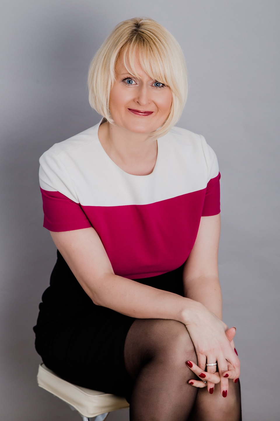 Consultant headshot in stripy dress